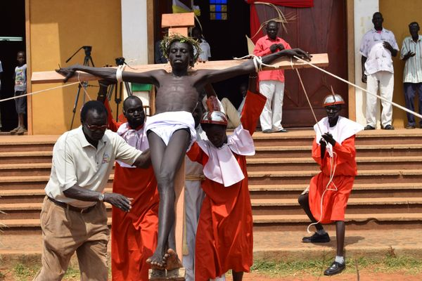 People perform crucifixion of Jesus Christ during the Good Friday ahead of the Easter in Juba, South Sudan on March 25, 2016.