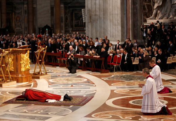 Pope Francis lies on the floor during the celebration of the Lord's Passion on Good Friday at St Peter's Basilica in Vatican