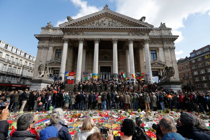 The Brussels Philharmonic Orchestra plays on the steps of the old stock exchange building in Brussels following Tuesday's bom