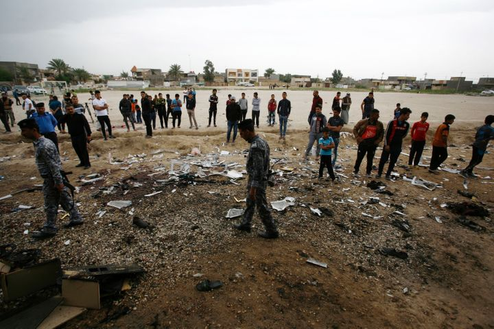 The scene after the blast in Iskandariya, a mixed Sunni and Shi'ite Muslim town south of Baghdad.