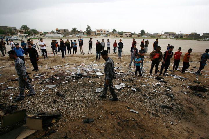 Thescene after the blast inIskandariya, a mixed Sunni and Shi'ite Muslim town south of Baghdad.