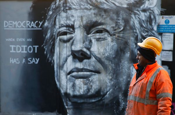 Furia ACK sprayed this portrait of Donald Trump in London's East End in January -- only to then pelt it with raw eg