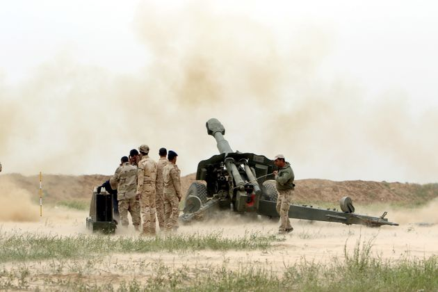Iraqi soldiers launch artillery toward Islamic State militants on the outskirt of the Makhmour south...