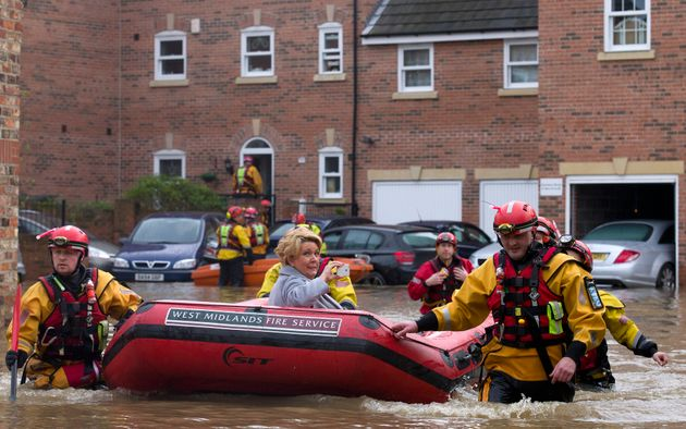 A woman being rescued in floods in York in December