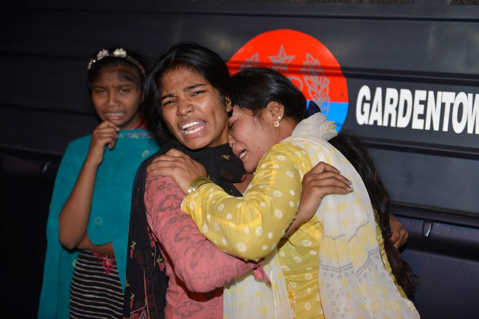 Pakistani women mourn the death of relatives after the bombing of a public park in Lahore.