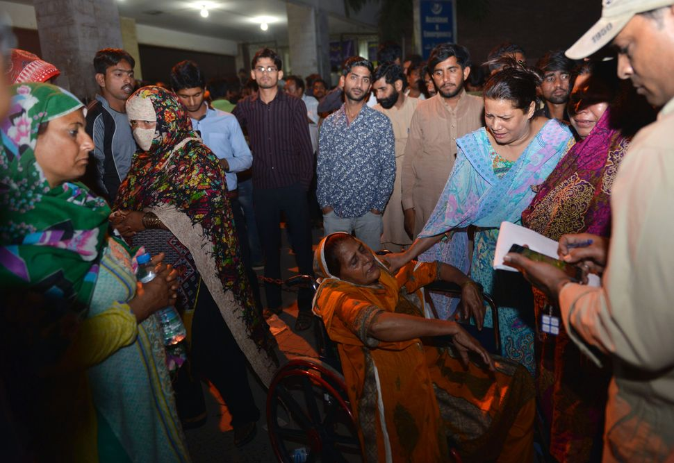 Pakistani relatives of injured victims gather outside the hospital in Lahore, Pakistan following the deadly blast.