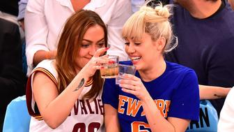 NEW YORK, NY - MARCH 26:  Brandi Cyrus and Miley Cyrus attend the Cleveland Cavaliers vs New York Knicks game at Madison Square Garden on March 26, 2016 in New York City.  (Photo by James Devaney/GC Images)