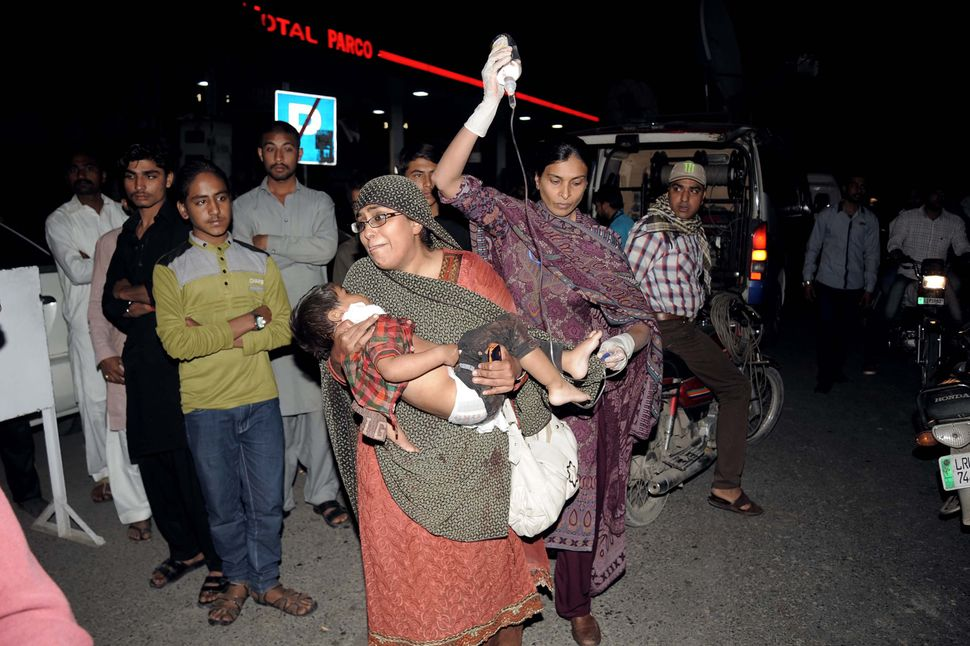 A Pakistani family brings an injured child to the hospital in Lahore on March 27, 2016.