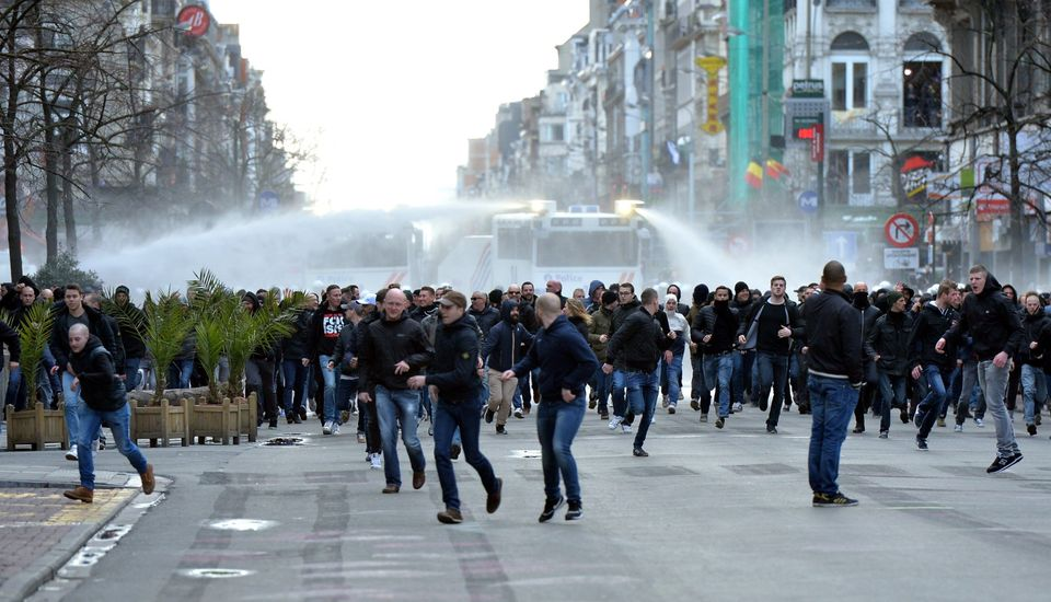 Brussels Police Fire Water Cannon As Right-Wing Protesters Trample Attacks