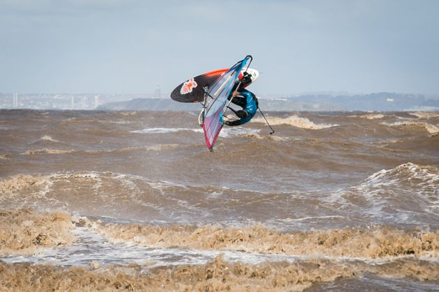 A windsurfer performs a front flip whilst taking advantage of high winds at Weston-super-Mare,