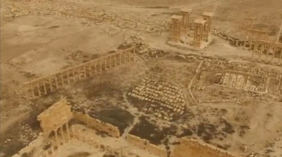 An aerial view of Palmyra on March 28 shows that many of the ancient city's monuments were still standing.