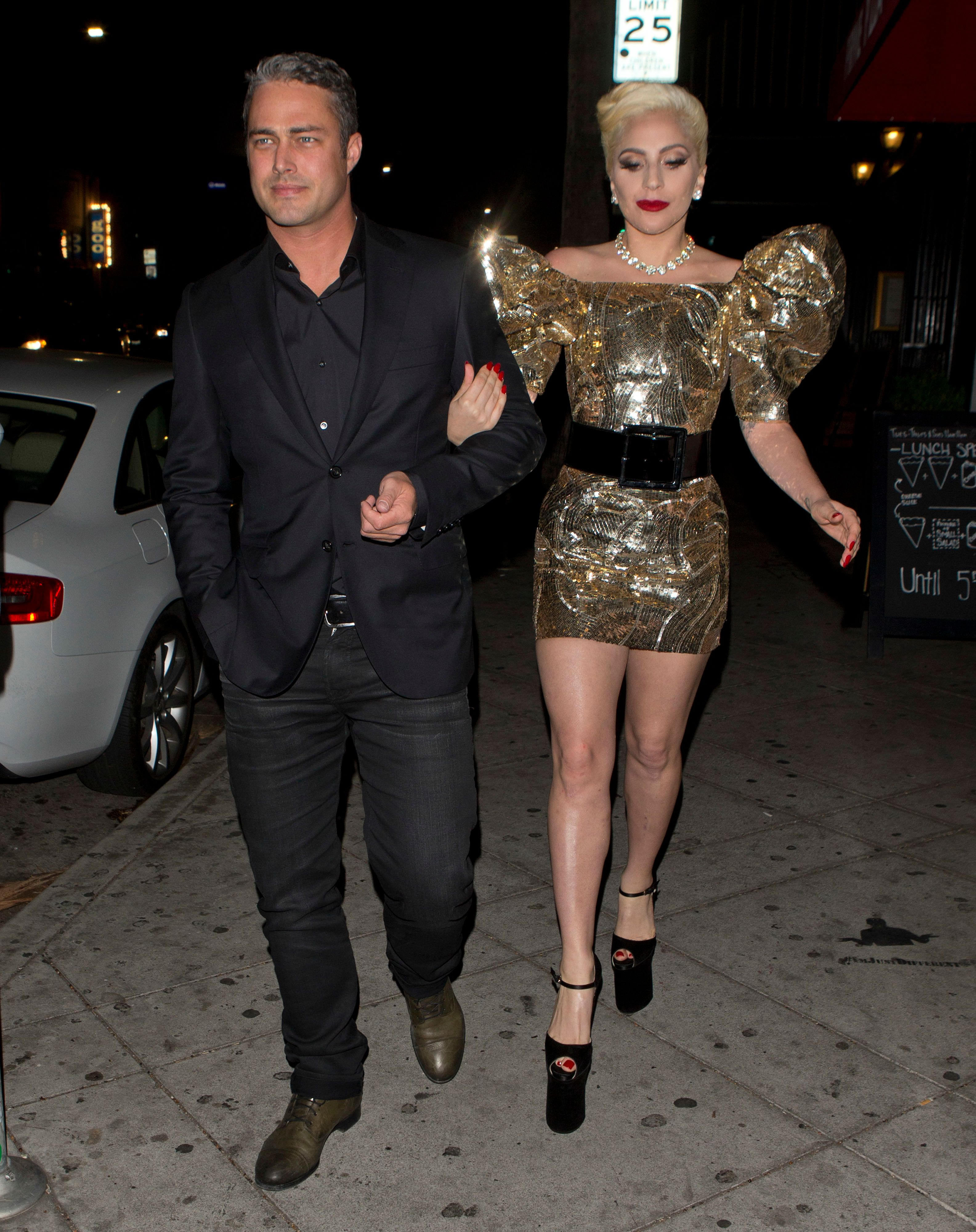 Gaga arrived on the arm of fiancé Taylor