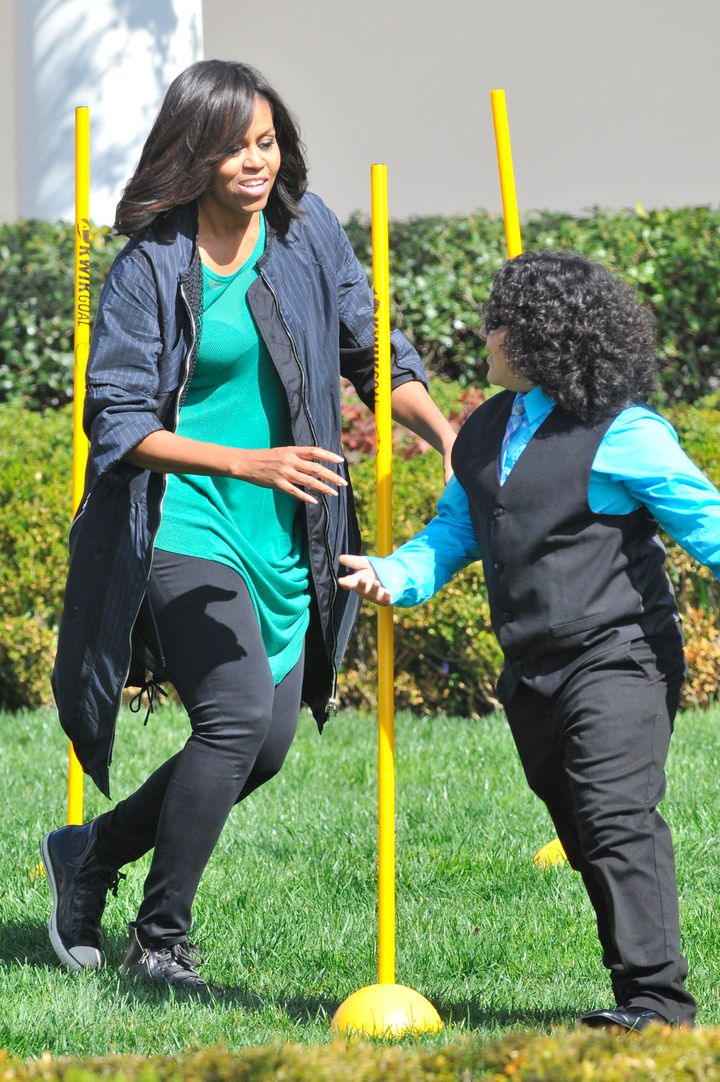 Michelle Obama searches for eggs atthe White House Easter Egg Roll on Monday.