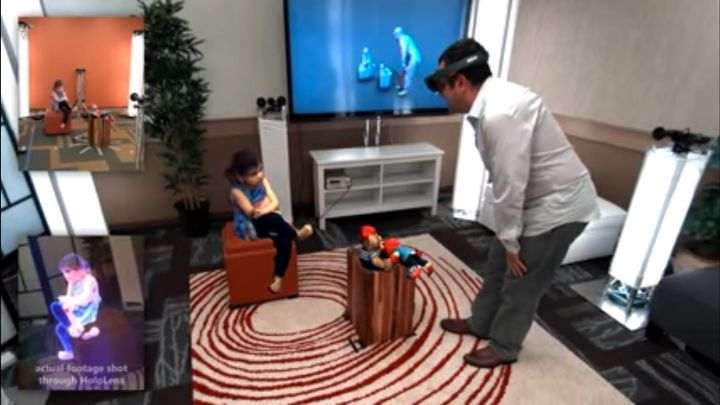 A Microsoft employee is seen viewing a 3D version of his daughter in real-time thanks to holoportation. The box on the bottom