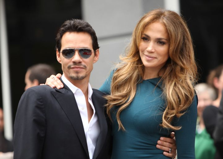 Marc Anthony and Jennifer Lopez attend the ceremony honoring Simon Fuller with a Star on The Hollywood Walk of Fame held on M