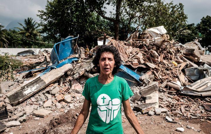 Brazilian Maria da Penha Macena speaks after her house was demolished, at Rio de Janeiro's Vila Autodromo neighbourhood near