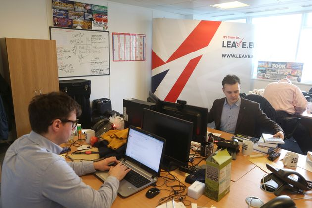 Employees work at their desks inside the Leave.EU campaign headquarters, a party campaigning against...