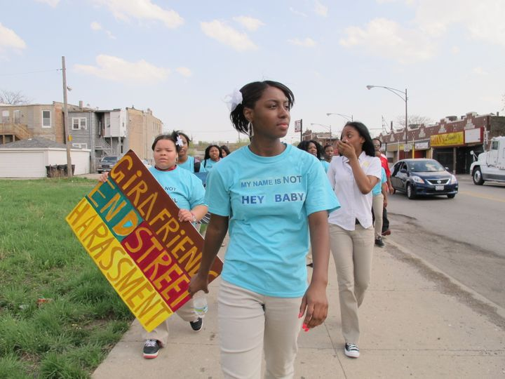 Participants with A Long Walk Home stage a neighborhood march on International Anti-Street Harassment Day.