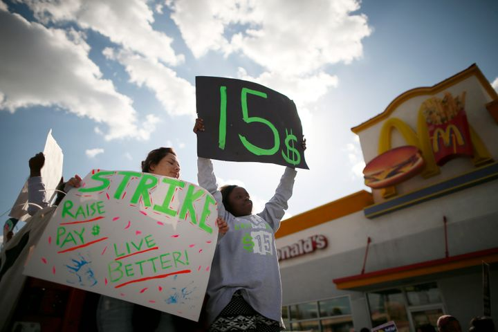 Protesters outside a McDonald's in Los Angeles call for a $15 minimum wage in December 2013.