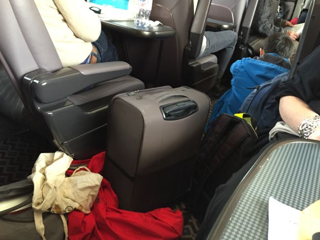 Luggage spills into the aisles on the packed