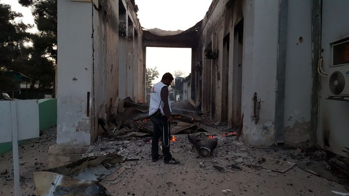 An MSF staffer surveys the damage following the U.S. military's strikes on the Kunduz trauma center on Oct. 3. The ICU was th