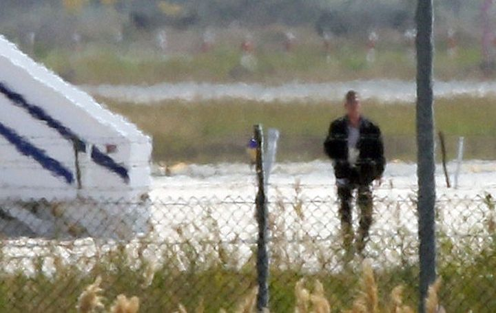 A man thought to be the hijacker leaves the hijacked Egyptair Airbus A320 at Larnaca Airport in Larnaca, Cyprus, on Tuesday.