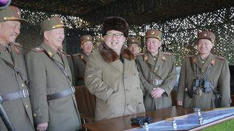 North Korean leader Kim Jong Un smiles with military officers as he observes a military drill at an unknown location, in this undated photo released by North Korea's Korean Central News Agency (KCNA) on March 25, 2016. REUTERS/KCNA ATTENTION EDITORS - THIS PICTURE WAS PROVIDED BY A THIRD PARTY. REUTERS IS UNABLE TO INDEPENDENTLY VERIFY THE AUTHENTICITY, CONTENT, LOCATION OR DATE OF THIS IMAGE. FOR EDITORIAL USE ONLY. NOT FOR SALE FOR MARKETING OR ADVERTISING CAMPAIGNS. THIS PICTURE IS DISTRIBUTED EXACTLY AS RECEIVED BY REUTERS, AS A SERVICE TO CLIENTS. NO THIRD PARTY SALES. SOUTH KOREA OUT. NO COMMERCIAL OR EDITORIAL SALES IN SOUTH KOREA      TPX IMAGES OF THE DAY