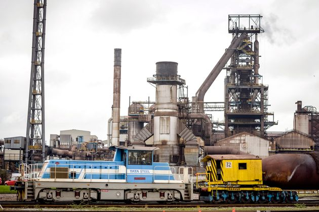A train carrying molten iron in front of the steel factory building at the Tata steel plant in Port