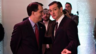 U.S. Senator Ted Cruz, a Republican from Texas and presidential candidate, right, speaks with Scott Walker, governor of Wisconsin, during the Iowa Faith & Freedom Coalition presidential forum at Point of Grace Church in Waukee, Iowa, U.S., on Saturday, April 25, 2015. Declared and undeclared Republican presidential candidates descended on Iowa for the event. Photographer: Daniel Acker/Bloomberg via Getty Images