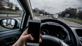 Using a phone while driving a car