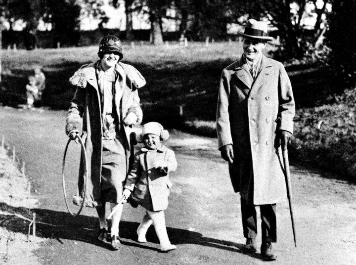 Zelda Fitzgerald and her husband, F. Scott Fitzgerald, walk with their daughter, Scottie.