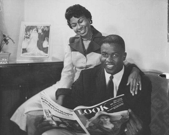 Rachel Robinson and her husband, Jackie Robinson, read Look Magazine.