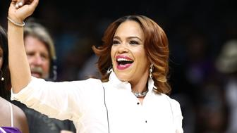 LOS ANGELES, CA - AUGUST 30:  Recording artist Faith Evans performs during timeout at the San Antonio Stars vs the Los Angeles Sparks during a WNBA game on August 30, 2015 in Los Angeles, California.  (Photo by Leon Bennett/Getty Images)