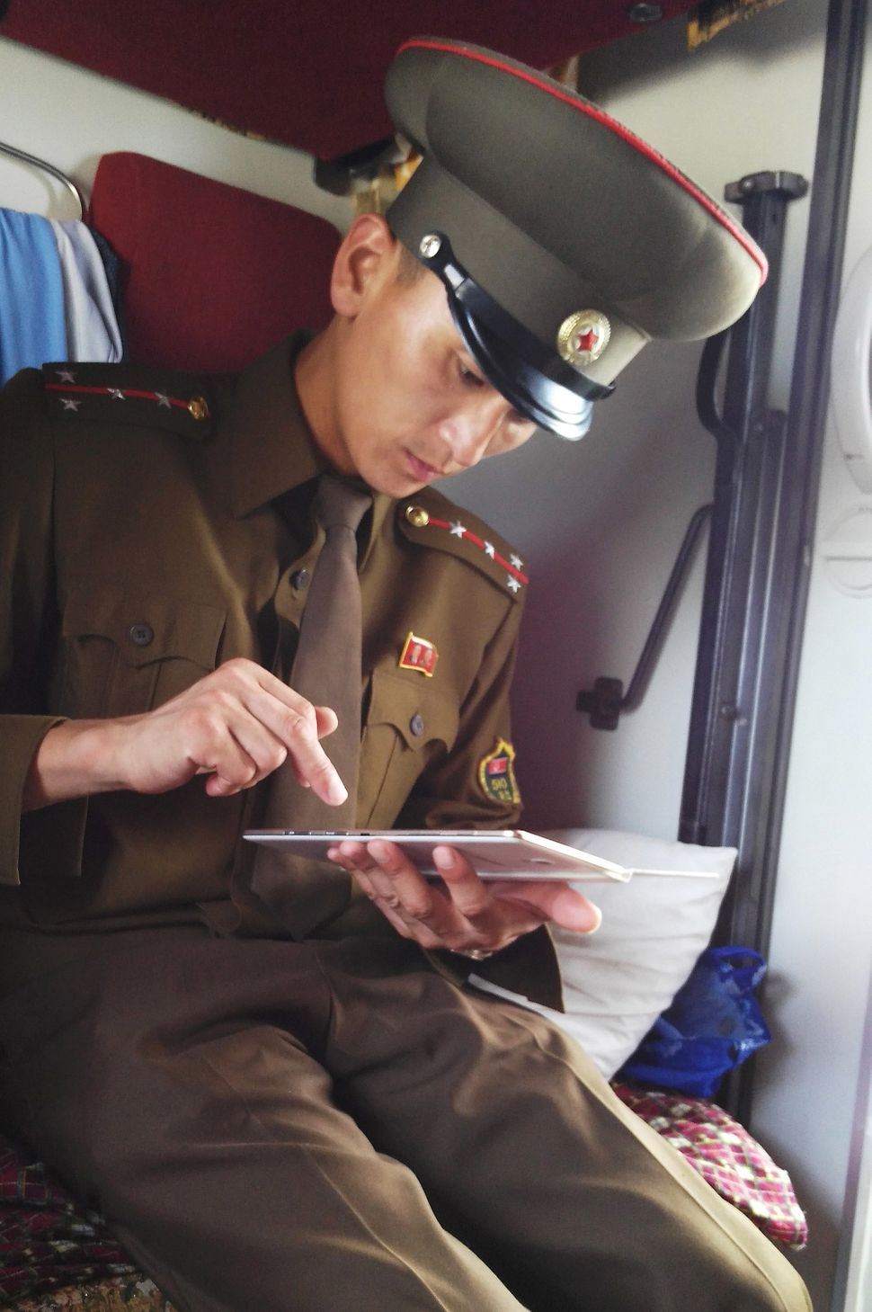 A customs officer checks a passenger's mobile device.
