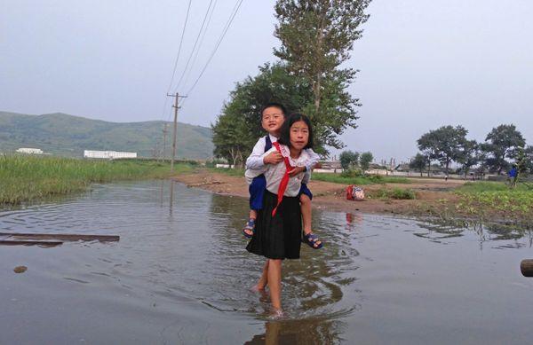 Children walk to school on Aug. 20.
