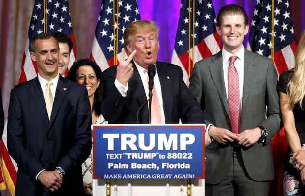 Republican U.S. presidential candidate Donald Trump stands between his campaign manager Corey Lewandowski...