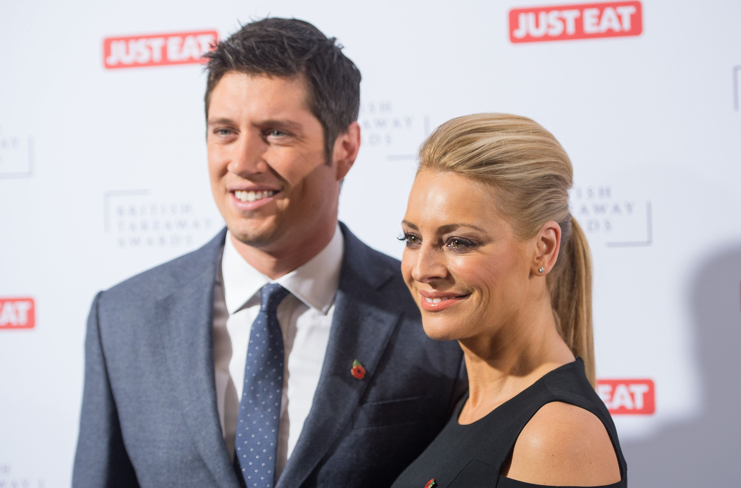 Vernon Kay with his wife Tess Daly, whom he says is completely aware of his recent communications with...
