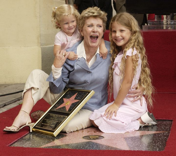 Patty Duke poses for photographers with her granddaughters, 2-year-old Elizabeth Astin and 7-year-old Alexandra Astin followi