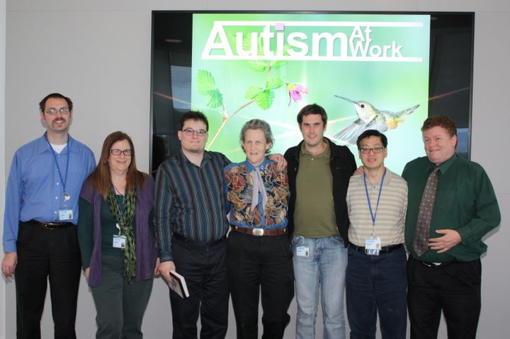 Employees at SAP's Palo Alto campus pose with autism advocate Temple Grandin, who visited on the one-year anniversary of