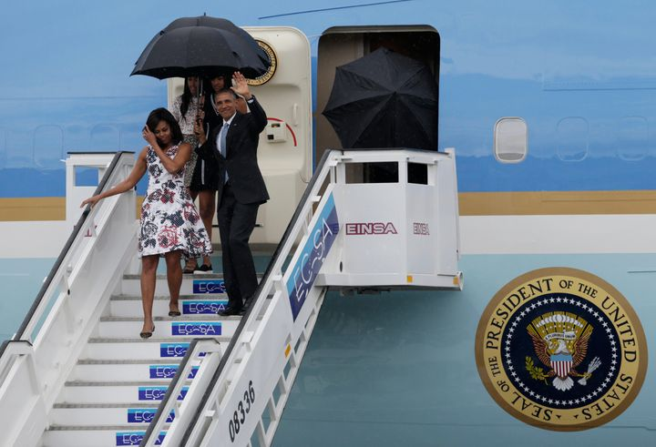 U.S. President Barack Obama, his wife Michelle, and their daughters Malia and Sasha, exit Air Force One as they arrive at Hav
