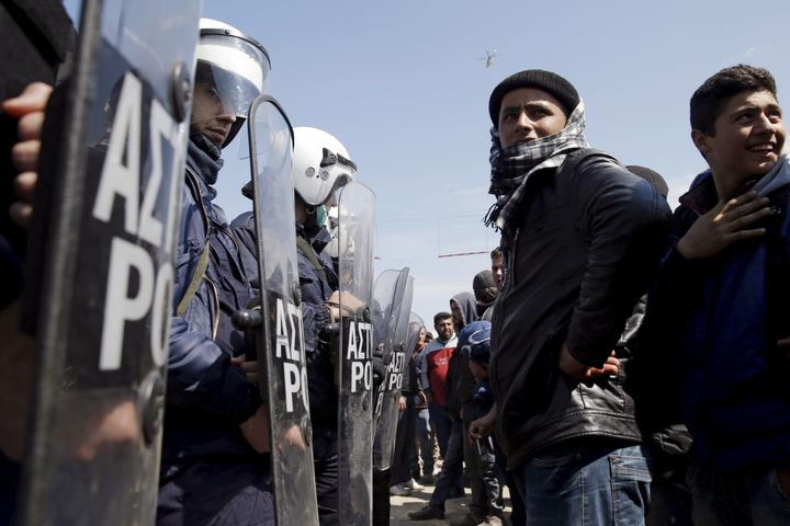 Scuffles between Greek police and migrants and refugees broke out at a camp on the Greece-Macedonia border when police attemp
