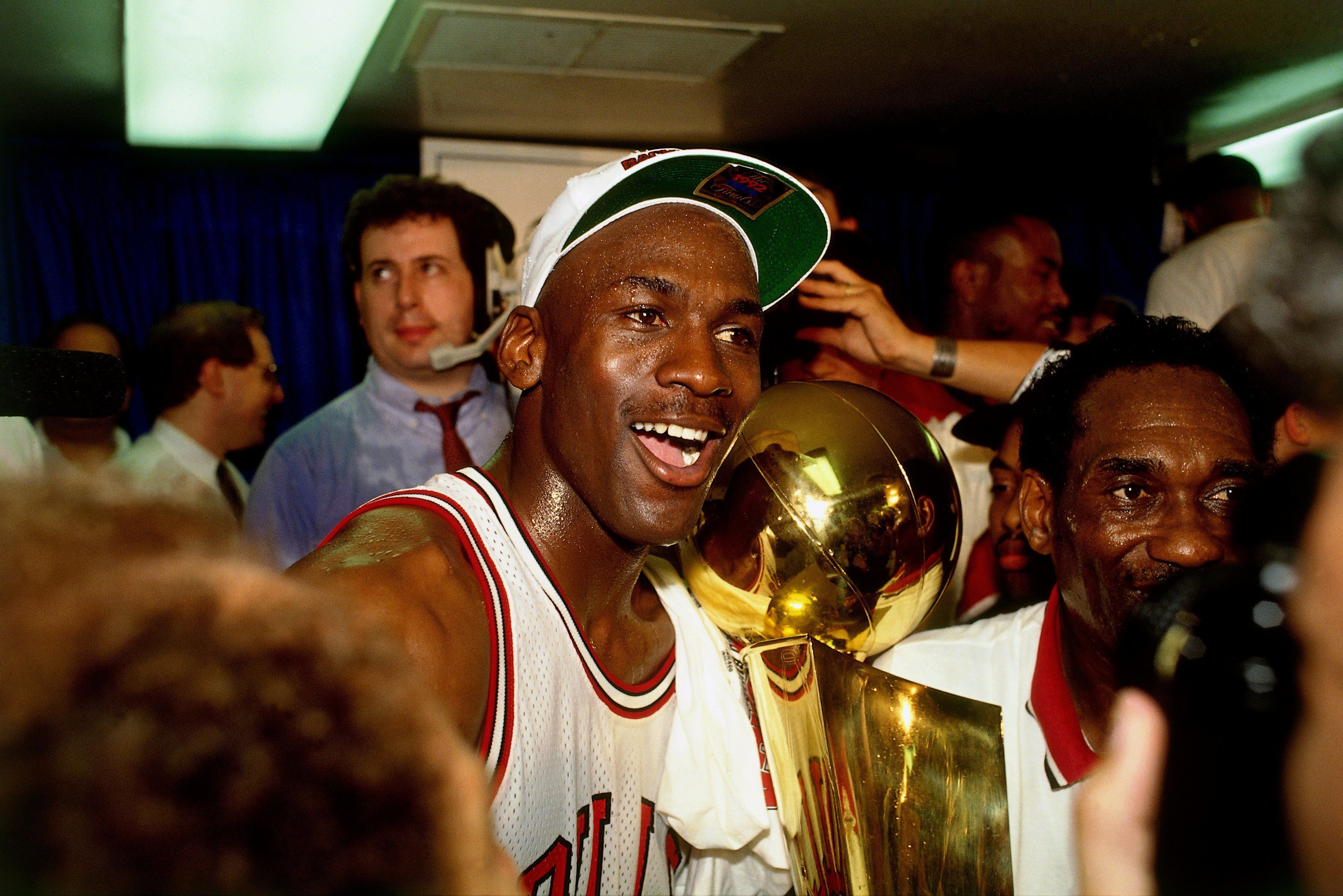 CHICAGO, IL - JUNE 14: Michael Jordan #23 of the Chicago Bulls celebrates after Game 6 of the NBA Finals against the Portland Trail Blazers on June 14, 1992 at Chicago Stadium in Chicago, Illinois.  The Bulls defeated the Trail Blazers 97-93 and 4-2.  NOTE TO USER: User expressly acknowledges that, by downloading and or using this photograph, User is consenting to the terms and conditions of the Getty Images License agreement. Mandatory Copyright Notice: Copyright 1992 NBAE (Photo by Nathaniel S. Butler/NBAE via Getty Images)
