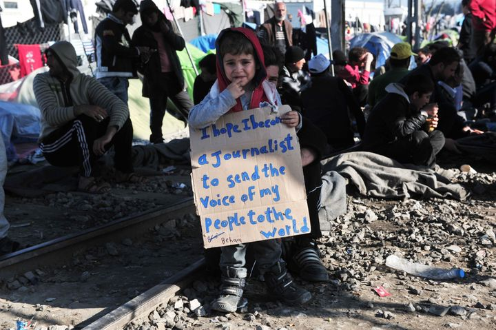 """This young boy joined the protesters on the tracks, holding a placard reading """"I hope I become a journalist to send the voice"""