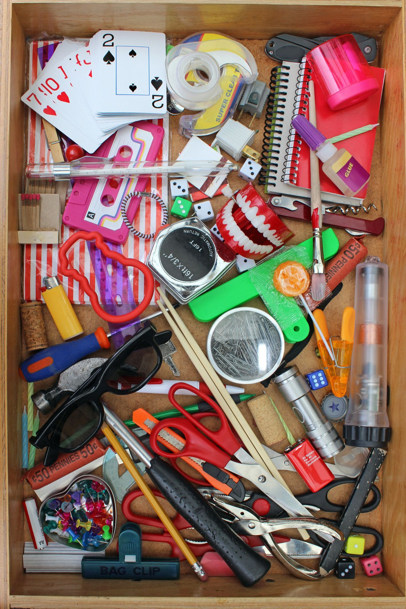 Junk drawer full of various household objects.