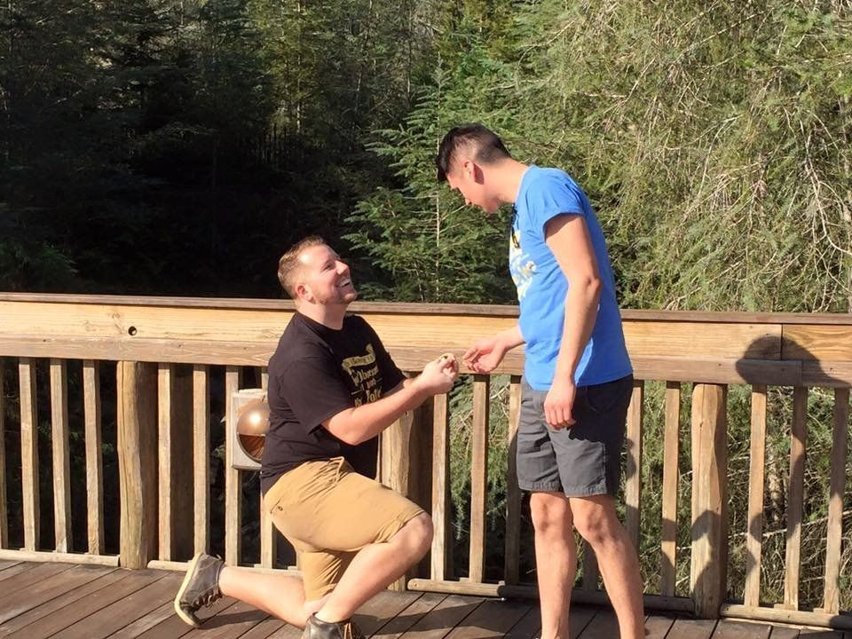 Derrick Walker pops the question to boyfriend Garrett Galvan at The Wizarding World of Harry Potter in Orlando, Florida.