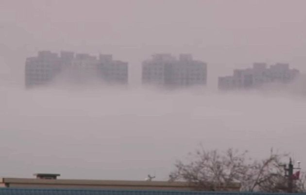 Buildings appear to mysteriously rise above a layer of fog in China's Liaoning Province, prompting speculation...