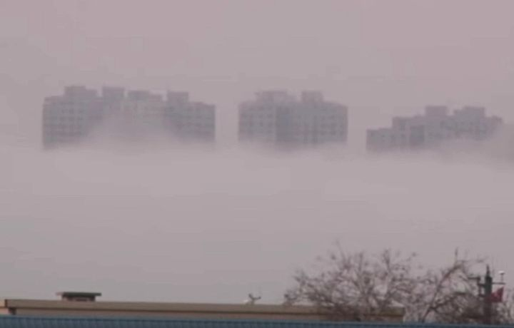 Buildings appear to mysteriously rise above a layer of fog in China's Liaoning Province, prompting speculation as to the caus