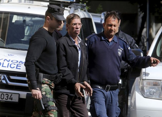 The alleged hijacker is led away by