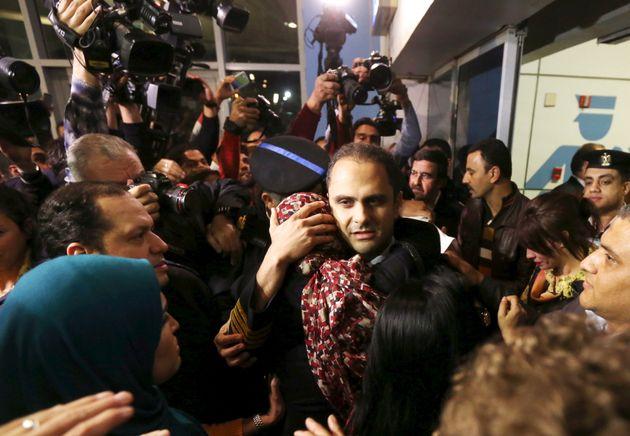The flight'spilot Amr al-Jamal embraces a family member after arriving at Cairo international