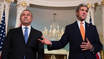 US Secretary of State John Kerry and Turkish Foreign Minister Mevlut Cavusoglu during a press availability at the State Department in Washington, DC March 28, 2016. / AFP / Jim Watson        (Photo credit should read JIM WATSON/AFP/Getty Images)
